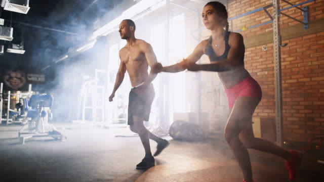 couple doing gym/ mielec/ poland - podkarpackie voivodeship video stock e b–roll