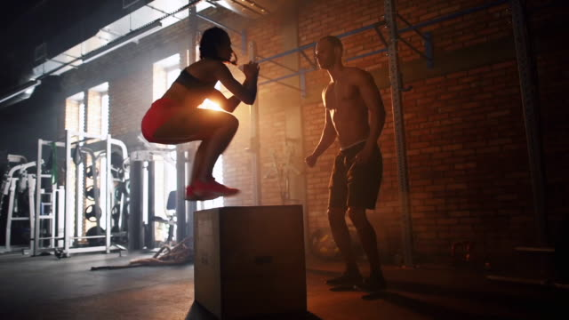 couple doing jump box/ mielec/ poland - cross training stock videos & royalty-free footage