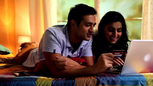 Couple doing online shopping on laptop, Delhi, India