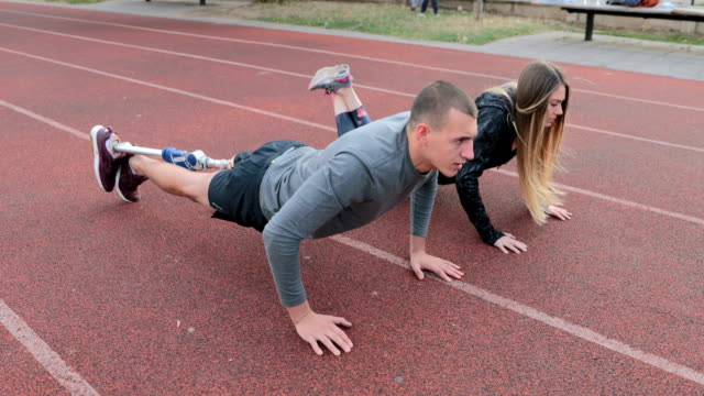 couple doing push-ups - amputee stock videos & royalty-free footage
