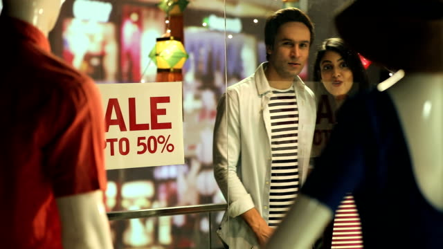 Couple doing window shopping, Delhi, India