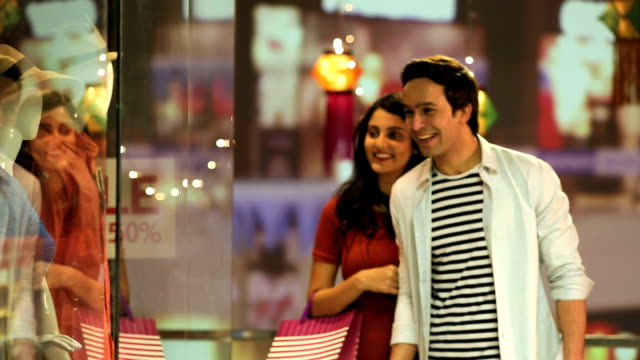 couple doing window shopping, delhi, india - colour image stock videos & royalty-free footage