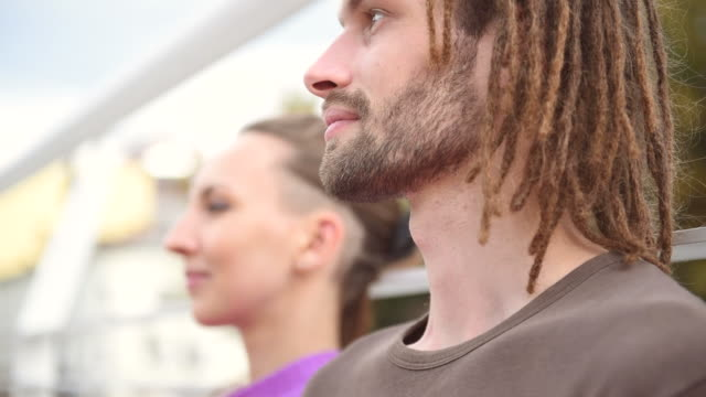 couple doing yoga together - dreadlocks stock videos & royalty-free footage
