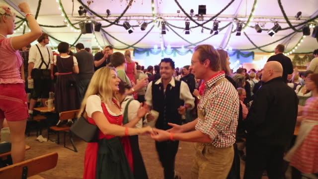 MS Couple dressed in traditional Bavarian dress dancing at traditional Oktoberfest / Munich, Bavaria, Germany
