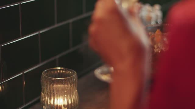 couple drinking cocktails on a romantic date sitting at bar at night - sunday stock videos & royalty-free footage