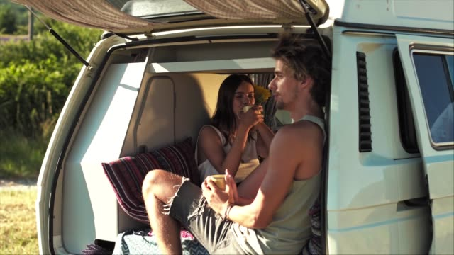 couple drinking coffee in van during vacation - coffee cup stock videos & royalty-free footage