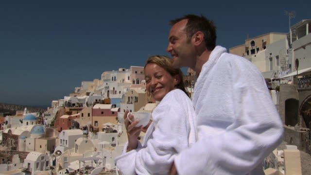 a couple drinking coffee on a balcony in santorini - see other clips from this shoot 1144 stock videos & royalty-free footage