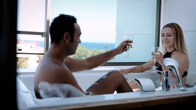 couple drinking in the hot tub - honeymoon stock videos and b-roll footage