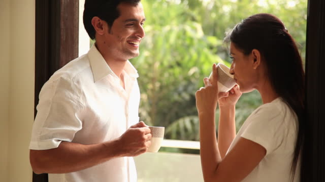 couple drinking tea in the morning  - indian couple tea stock videos & royalty-free footage
