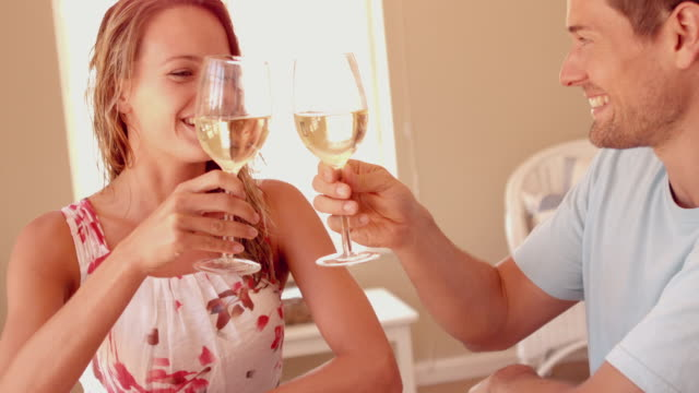 Couple drinking white wine together on holiday