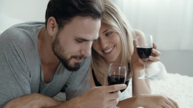couple drinking wine in the bedroom - dating stock videos & royalty-free footage
