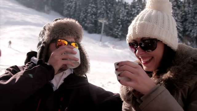 a couple drinks coffee on the ski slopes - ski stock videos & royalty-free footage