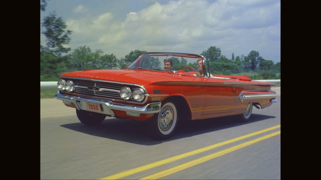 ms ts couple driving 1960 chevrolet impala car on road / united states - horseless carriage stock videos & royalty-free footage