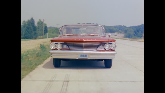 ms pov couple driving 1960 pontiac catalina car on road / united states - pontiac stock videos and b-roll footage