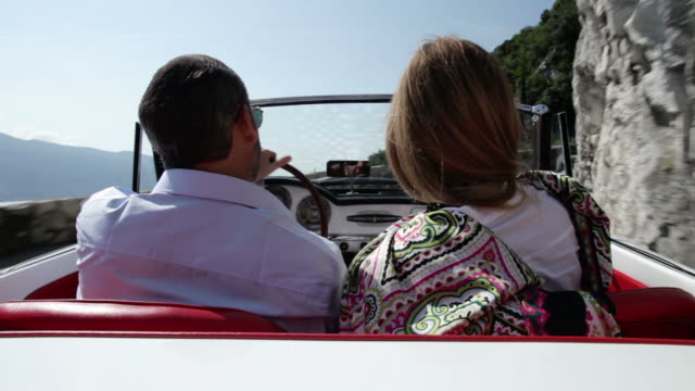 couple driving cabriolet - classic car stock videos and b-roll footage