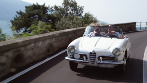 couple driving cabriolet - italy stock videos & royalty-free footage