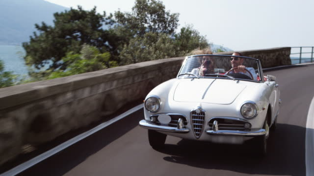couple driving cabriolet - luxury stock videos & royalty-free footage