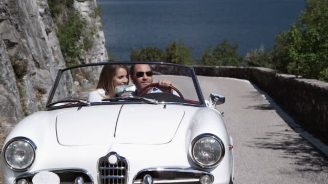 couple driving cabriolet - man convertible stock videos & royalty-free footage