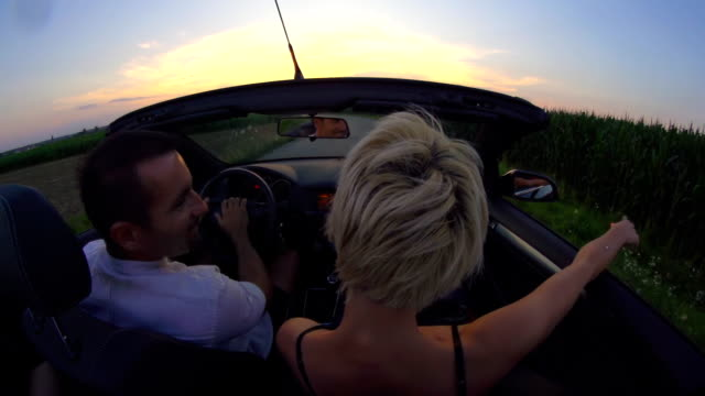 hd slow motion: couple driving late in convertible - convertible stock videos & royalty-free footage