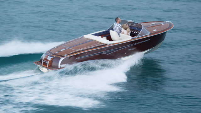 couple driving on yacht - yacht stock videos & royalty-free footage