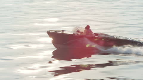 couple driving on yacht - speed boat stock videos & royalty-free footage