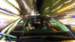 Couple Driving Through Manhattan at Night - Time Lapse