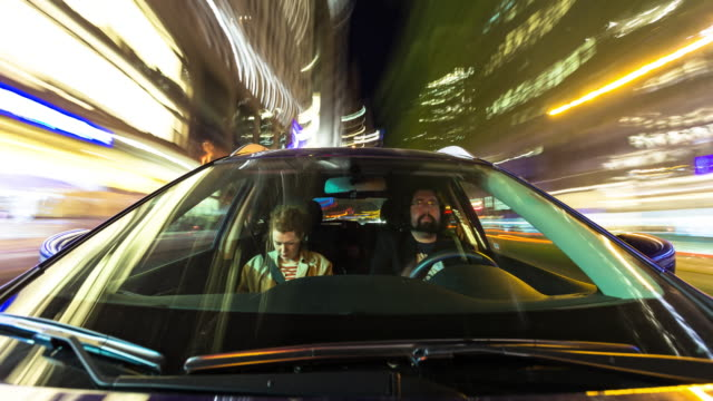 couple driving through manhattan at night - time lapse - driver stock videos & royalty-free footage