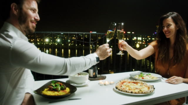 couple during romantic dinner - dining stock videos & royalty-free footage