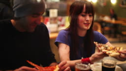 Couple eat pizza
