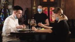 Couple eating at bar reopening after quarantine restriction
