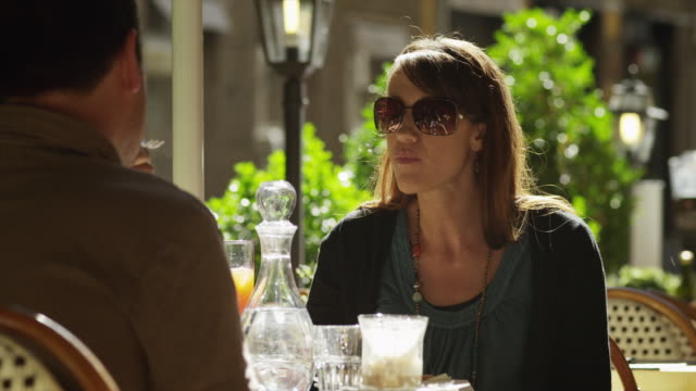 ms couple eating at outdoor cafe / florence,tuscany - florence italy stock videos and b-roll footage
