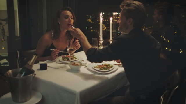 couple eating dinner - flirting stock videos & royalty-free footage