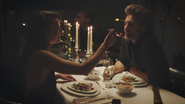 couple eating dinner - candlelight stock videos & royalty-free footage
