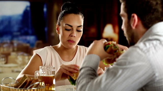 Couple eating fast food in a restaurant