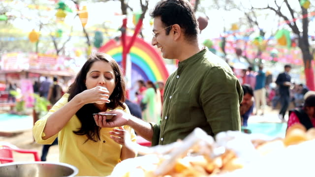 couple eating golgappe at suraj kund fair, haryana, india - snack stock videos and b-roll footage