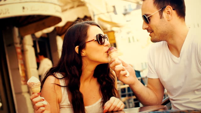 couple eating ice cream at a cafe slow motion. - toned image stock videos & royalty-free footage