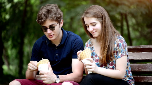 couple eating ice cream in park - gelato stock videos & royalty-free footage