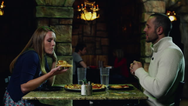 ms couple eating pizza in restaurant / orem, utah, usa - orem utah stock videos & royalty-free footage