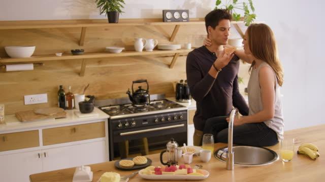 vídeos de stock, filmes e b-roll de couple eating - waffles