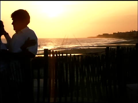 couple embracing at sunset - see other clips from this shoot 1335 stock videos and b-roll footage