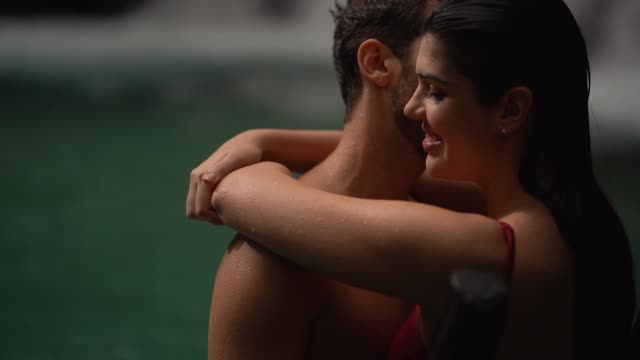 couple embracing in waterfall - romantic activity stock videos & royalty-free footage