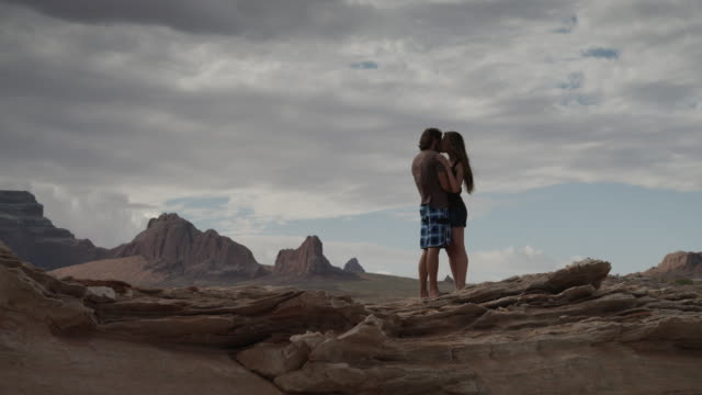 ws ds couple embracing near lake powell / utah, usa - lake powell stock videos and b-roll footage