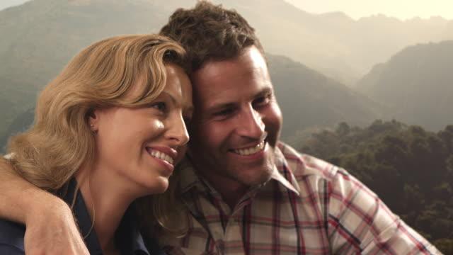 Couple embracing on mountain peak/Marbella region, Spain
