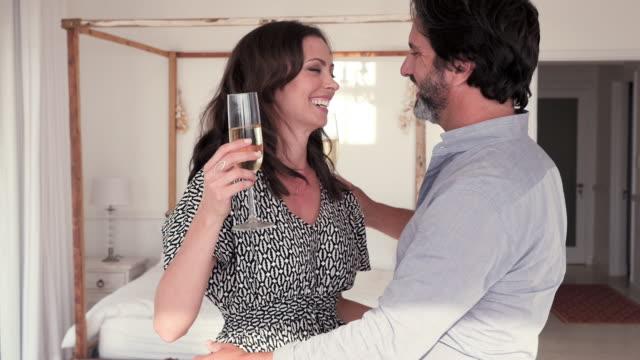 stockvideo's en b-roll-footage met couple embracing - dubbel bed