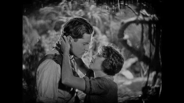 1925 Couple endulge in dramatic embrace before woman walks away