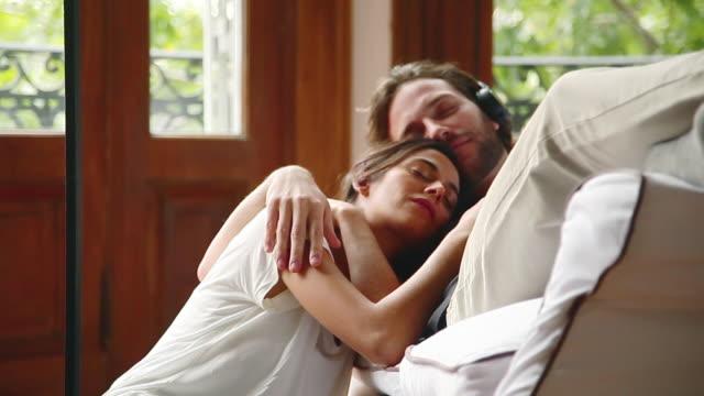 Couple enjoying afternoon nap together