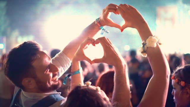 couple enjoying at a concert, 4k. - party social event stock videos and b-roll footage