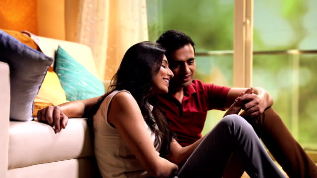 couple enjoying at home, delhi, india - 床に座る点の映像素材/bロール