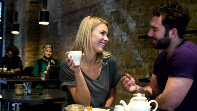 couple enjoying cake and coffee in cafe - romance stock videos & royalty-free footage