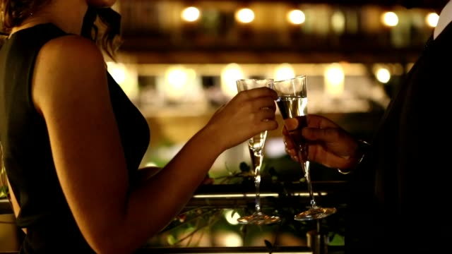 couple enjoying champagne - bar video stock e b–roll